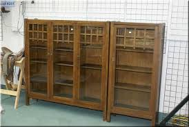 antique quarter cut oak mission style three door bookcase by north