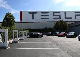 tesla factory tesla factory workers allege insults and graffiti in