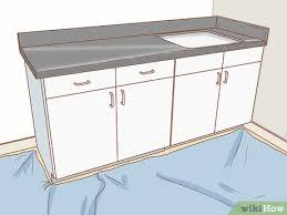 best laminate kitchen cupboard paint 3 ways to paint laminate cabinets wikihow