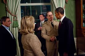 file obama shakes hands with an admiral in green room after