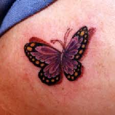 small butterfly designs place on my ankle nation