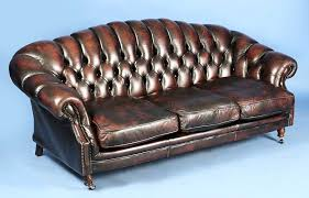 vintage rust colored leather chesterfield sofa and arm chair