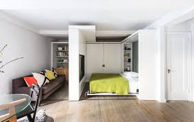 390 square foot micro apartment with multifunctional sliding wall