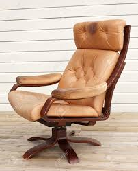 Brown Leather Recliner Chairs Old Worn And Dirty Brown Leather Recliner Chair Stock Photo