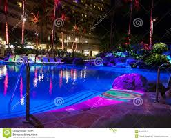 hotel pool at night with colorful lights stock photo image 48202351