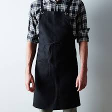 black cross back kitchen apron with black ties on food52