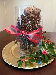 brown pines on the glass with red ribbon placed on the golden