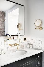 black bathroom mirrors inside a jewelry designer s understated brooklyn home white subway