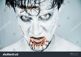 scary halloween photo background scary zombie man blood on white stock photo 217444147 shutterstock