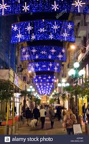 Christmas Decorations Street Lights by Strollers Enjoying The Christmas Street Light Decorations On The
