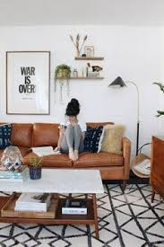 tan sofa decorating ideas tan sofa white walls light wooden flooring colourful