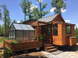 tiny home for sale the elsa tiny house has greenhouse and porch swing simplemost