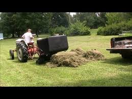 harvesting and using grass clippings as mulch to conserve water in