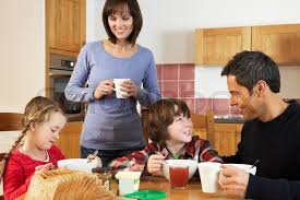family eating breakfast together in kitchen stock photo colourbox