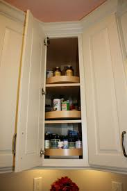 wood lazy susan in a diagonal corner wall cabinet cabinet