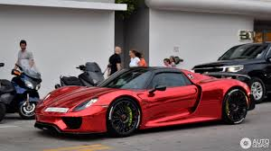 porsche spyder 918 porsche 918 spyder in chrome red makes it presence felt at miami