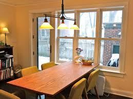simple wood wooden dining table black iron three armed hanging