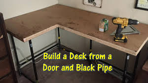 Diy Pipe Desk Build A Desk Using An Door And Black Pipe By Gettinjunkdone