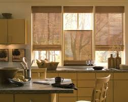 kitchen circular motif echoed by roman shade kitchen window