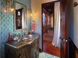 mediterranean powder room with interior wallpaper u0026 specialty door