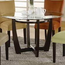 glass table black legs round glass dining table with dark brown wooden base on grey fur rug