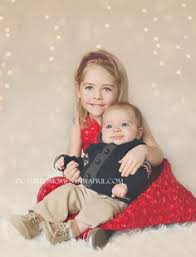 siblings photo christmas card with ikea fabric backdrop