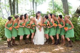 bridesmaid dresses with cowboy boots bridesmaids in emerald green dresses and the bridal wore