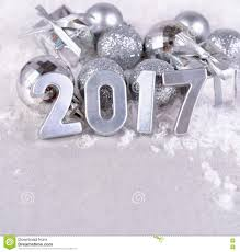 2017 year silver figures and silvery christmas decorations stock