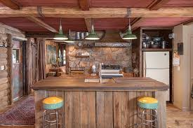 rustic paint color with unique yellow stools for english cottage