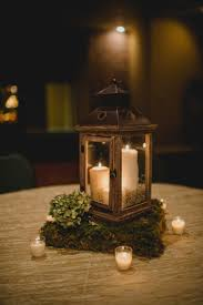 wooden lantern centerpiece with moss stand lanterns pinterest