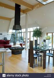 fire pit below tall chimney in centre of modern living and dining