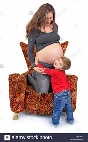 Leopard Armchair Pregnant Mother Kneeing On A Leopard Armchair Her Son Embracing