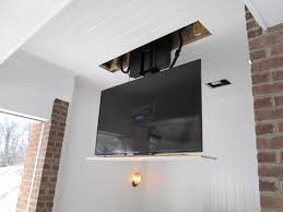 Drop Down Tv From Ceiling by Wilcox Architecture Disappearing Tv