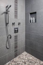 Modern Gray Tile Bathroom This Walk In Shower Is Decked Out With Chrome Danze Fixtures An