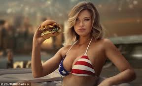 newest model carl s jr ceo apologizes to burger ad