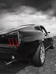 Black Fastback Mustang A 1969 Mach1 Ford Mustang In Black And White With Red Tail Lights