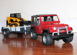 bruder toys jeep wrangler with trailer and cat skid steer unboxing bruder toys