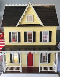 color scheme yellow with white trim black shutters red front