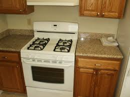 granite countertop green and white kitchen cabinets mexican