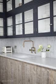 indigo uppers with glass fronts u0026 subway tile unlacquered brass