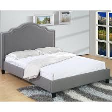 bedroom brown wooden platform with lamp site table red fur rug