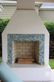 stucco fireplace with glass tile trim by hanna builders outdoor