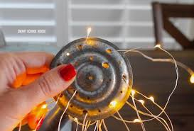 how to make fairy lights glowing watering can with fairy lights5 jpg