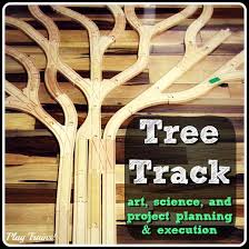 learning about trees with wooden tracks