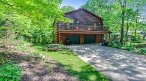 swan lodge lakeshore lodging welcome to swan lodge this log cabin style home sleeps 10