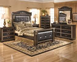 luxury bedroom ideas with gold colored bed linen and elegant black