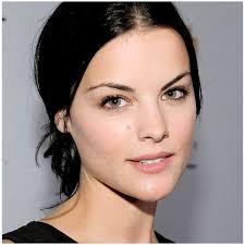 attractive middle aged women dark hair why is dark hair light eyes and white skin considered to be