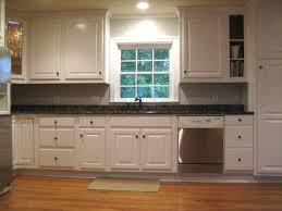 white kitchen cabinets backsplash kitchen remodels with white cabinets black kitchen countertop blue