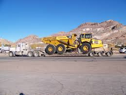 used volvo dump truck used volvo dump truck suppliers and file volvo a40e dumper hauled by a peterbilt truck jpg wikimedia