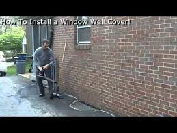 How To Cover Basement Windows by How To Install A Window Well Cover Youtube